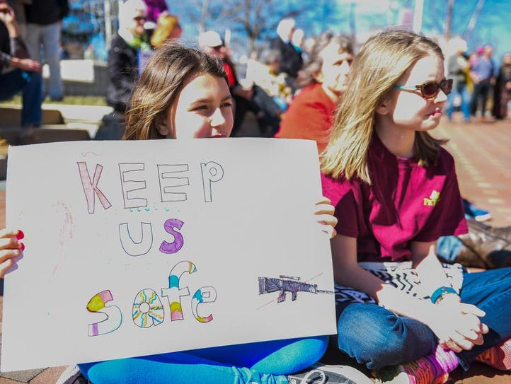 Over 100 people gathered in downtown Asheville on Sunday,