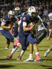 Blackman QB Connor Mitchell looks for running room Friday at Siegel.
