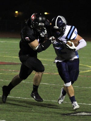 Livonia Churchill's Aaron Kerr hauls down Stevenson's Austin Petrie Friday night at Churchill. The Chargers won the game when senior quarterback Brian Alsobrooks pushed in a quarterback sneak from the six-inch line as time expired to give his team a 37-35 victory.