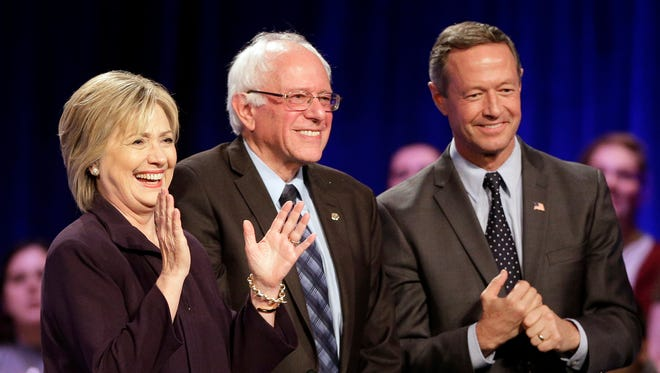 FILE - In this Nov. 6, 2015, file photo Democratic presidential candidates Hillary Rodham Clinton, from left, Sen. Bernie Sanders, I-Vt., and former Maryland Gov. Martin O'Malley, smile after a Democratic presidential candidate forum at Winthrop University in Rock Hill, S.C. Clinton has locked up public support from half of the Democratic insiders who cast ballots at the party's national convention, giving her a commanding advantage over her rivals for the party's presidential nomination. Clinton's margin over Sanders and O'Malley is striking. (AP Photo/Chuck Burton, File)
