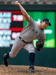 New York Yankees relief pitcher Tommy Kahnle throws to the Minnesota Twins in the eighth inning of a baseball game Wednesday, July 19, 2017, in Minneapolis.