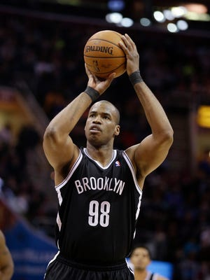 FILE - In this April 16, 2014, file photo, Brooklyn Nets' Jason Collins shoots against the Cleveland Cavaliers during an NBA basketball game  in Cleveland. Collins, the NBA's first openly gay player, announced his retirement on Wednesday, Nov. 19, 2014. (AP Photo/Tony Dejak, File)