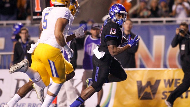 Boise State running back Jeremy McNichols runs for a touchdown during the first half against San Jose State.