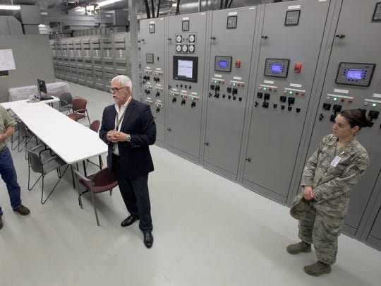 Don Boger, left, and John Raney give a tour of an electrical
