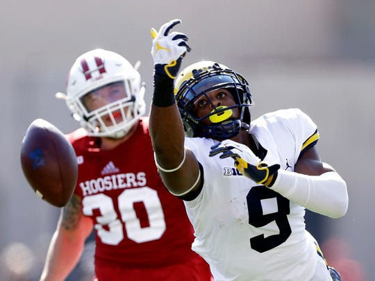 Michigan receiver Donovan Peoples-Jones comes up short on a pass against Indiana's Chase Dutra in the first half in Bloomington, Ind., Saturday, Oct. 14, 2017.
