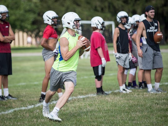 Muncie Central's football team practices drill outside