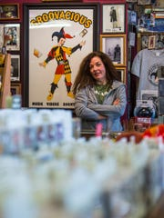 Lisa Cretsinger poses for a photo Thursday in Groovacious, her Cedar City record store.