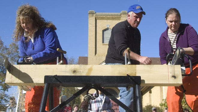 The Fall Festival of Leaves' log sawing contest is one of the popular events at Bainbridge.