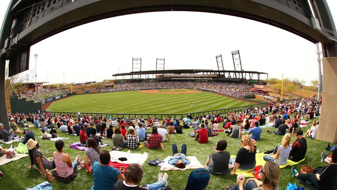 Fans watch the game on the left field lawn as the Arizona Diamondbacks play the Los Angeles Dodgers during spring training action on Mar. 3, 2017, at Salt River Fields near Scottsdale.