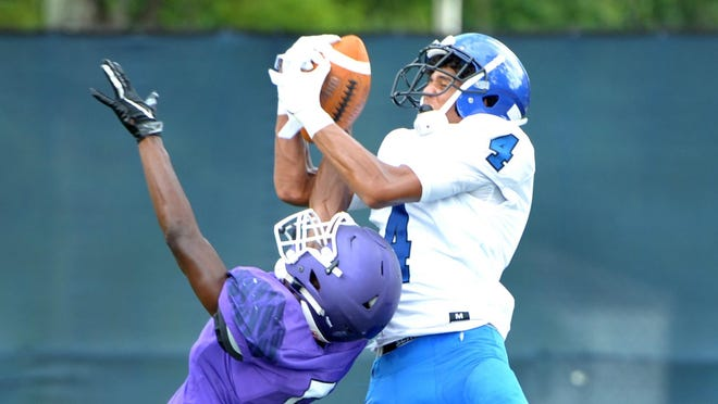 Trinity Christian wide receiver Marcus Burke (4) pulls in a pass against Fletcher in a 2019 football scrimmage. Burke, a four-star recruit committed to Florida, is one of the Times-Union's Super 11 selections.