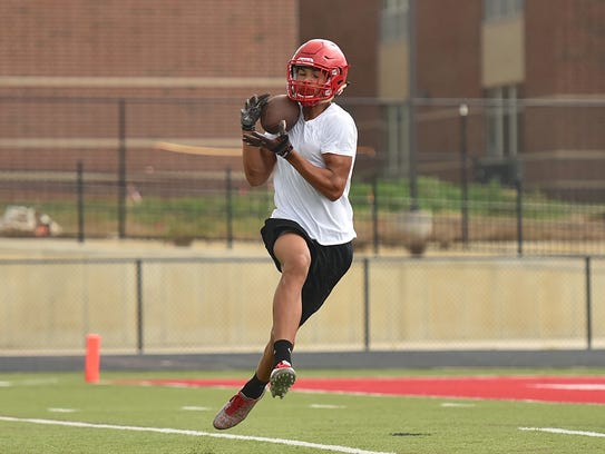 Fairfield's Erick All hauls in a catch against LaSalle