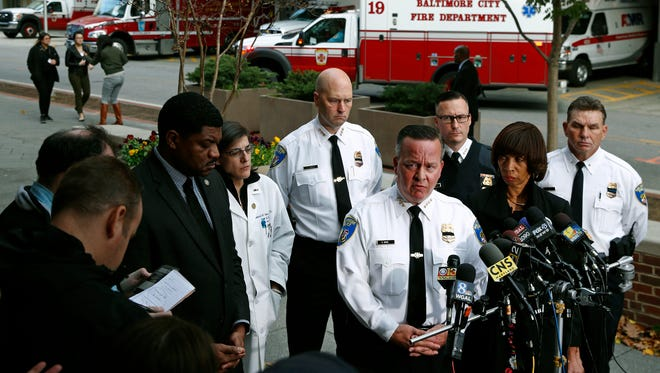 Baltimore Police Department Commissioner Kevin Davis, third from right, speaks alongside Mayor Catherine Pugh at a news conference outside the R Adams Cowley Shock Trauma Center in Baltimore, Thursday, Nov. 16, 2017, to announce the death of Det. Sean Suiter. Suiter was shot in the head Wednesday while working in a troubled area of the city grappling with high crime rates.