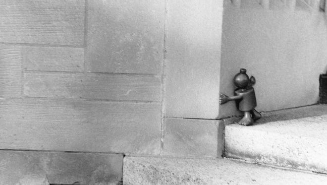 """Emani Rogers, a member of the Studio 678 Photo Club, took this photograph, """"Little Man at the MAG,"""" at the Memorial Art Gallery. The little man is part of artist Tom Otterness' """"Creation Myth"""" sculpture series."""