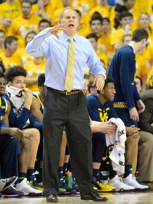 Michigan basketball coach John Beilein speaks to his team against the Maryland Terrapins at Xfinity Center.