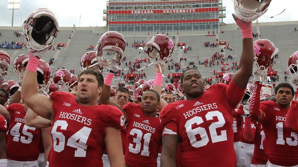 Indiana Hoosiers center Collin Rahrig (64) and offensive tackle Ralston Evans (62) sing the Indiana fight song to fans after defeating North Texas Mean Green at Memorial Stadium on Saturday.