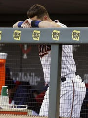Minnesota Twins' Trevor Plouffe rests his head on his hands in the final minutes of the April 11 game against the Chicago White Sox in Minneapolis.