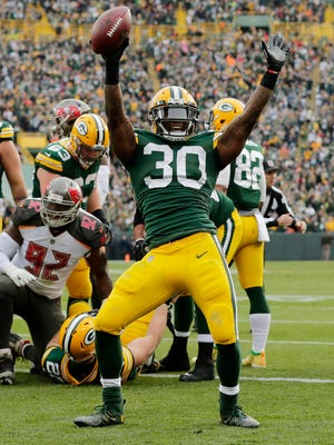 Green Bay Packers running back Jamaal Williams (30) celebrates after scoring a touchdown against the Tampa Bay Buccaneers in the second quarter at Lambeau Field on Sunday, December 3, 2017 in Green Bay, Wis.
