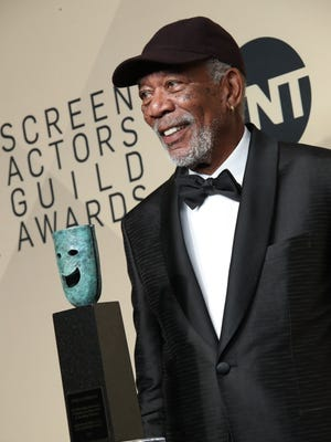 Morgan Freeman, seen here receiving the Golden Globes' lifetime achievement honor in 2012, was accused of sexual misconduct by CNN in a story that ran May 24.