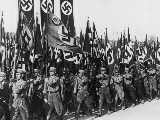 Nazis march at the Nuremberg Rally to mark the 6th