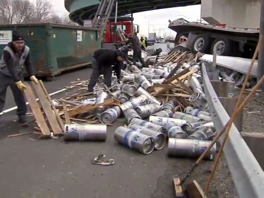 Tractor-trailer falls from overpass, spilling beer kegs onto 1-95 in