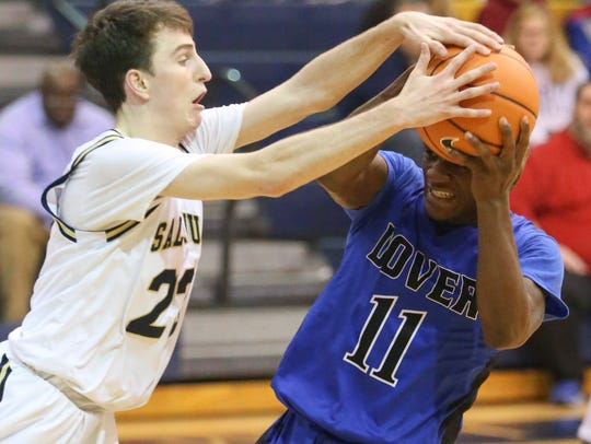 Salesianum's Mike Wallace (left) reaches for the ball