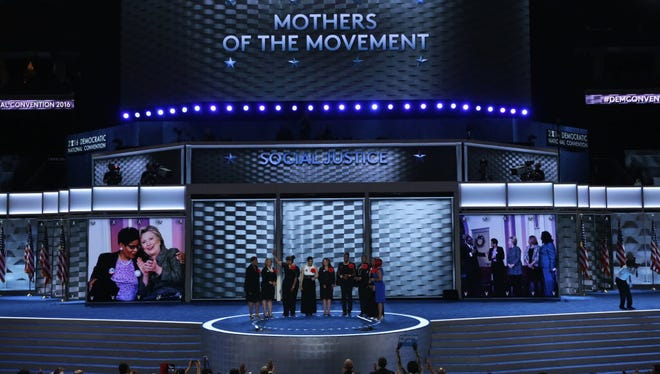 Maria Hamilton (far left) and other mothers who lost children to gun violence or after contact with police appeared at the 2016 Democratic National Convention. Hamilton's son, Dontre Hamilton, was killed by Milwaukee police in 2014.