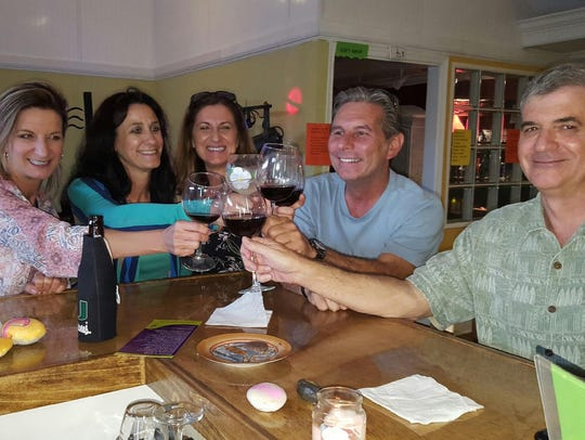 Friends have a toast at the new Notes Music Roon &