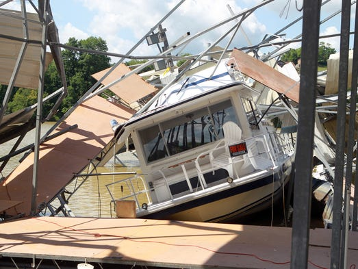 A canopy collapsed on this boat at Smuggler's Cove. Owner Tim Meyer said about 10 boats were damaged, but did not have a damage estimate.