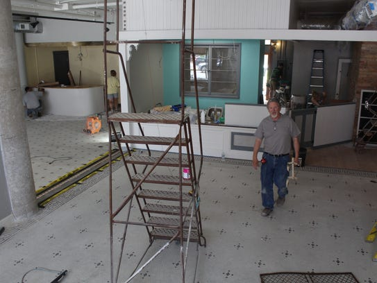 Pat Drury walks through the space that will become