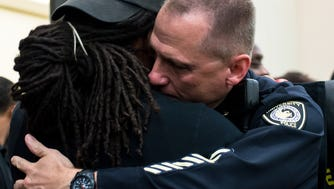 UCF Deputy Chief Brett Meade hugs a student after the Black Lives Matter vigil on Wednesday, July 13, 2016, in the Student Union's Pegasus Ballroom.