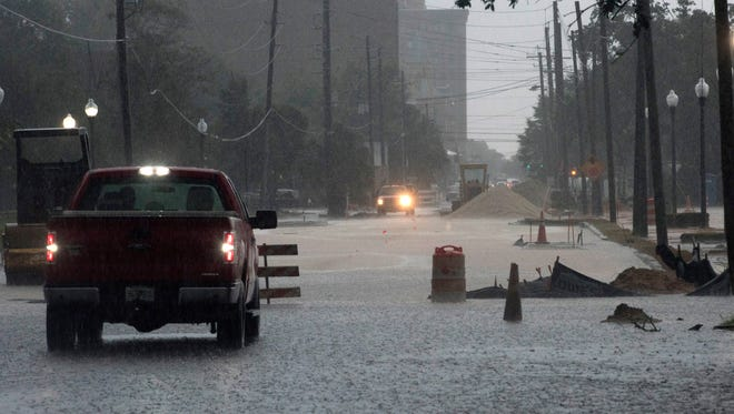 Rains from Harvey fall on Pensacola filling many local streets with ponding water Wednesday, Aug. 30, 2017.