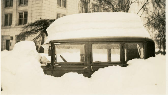 A car is completely blocked in by the heavy snows on Jan. 31, 1937, in Salem.