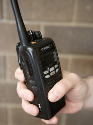 Lt. Patrick Zeps holds a VHF portable radio at the Marshfield Police Department earlier this year.