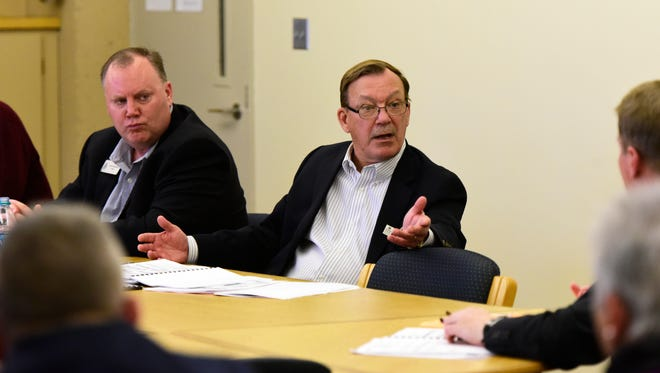 Trustee Michael Waleryszak asks Terra State Community College President Jerome Webster questions about enrollment at Wednesday's board meeting.