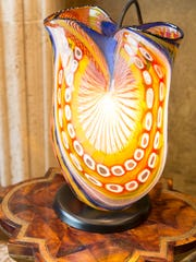 A Murano glass vase from Italy in the office of Bob