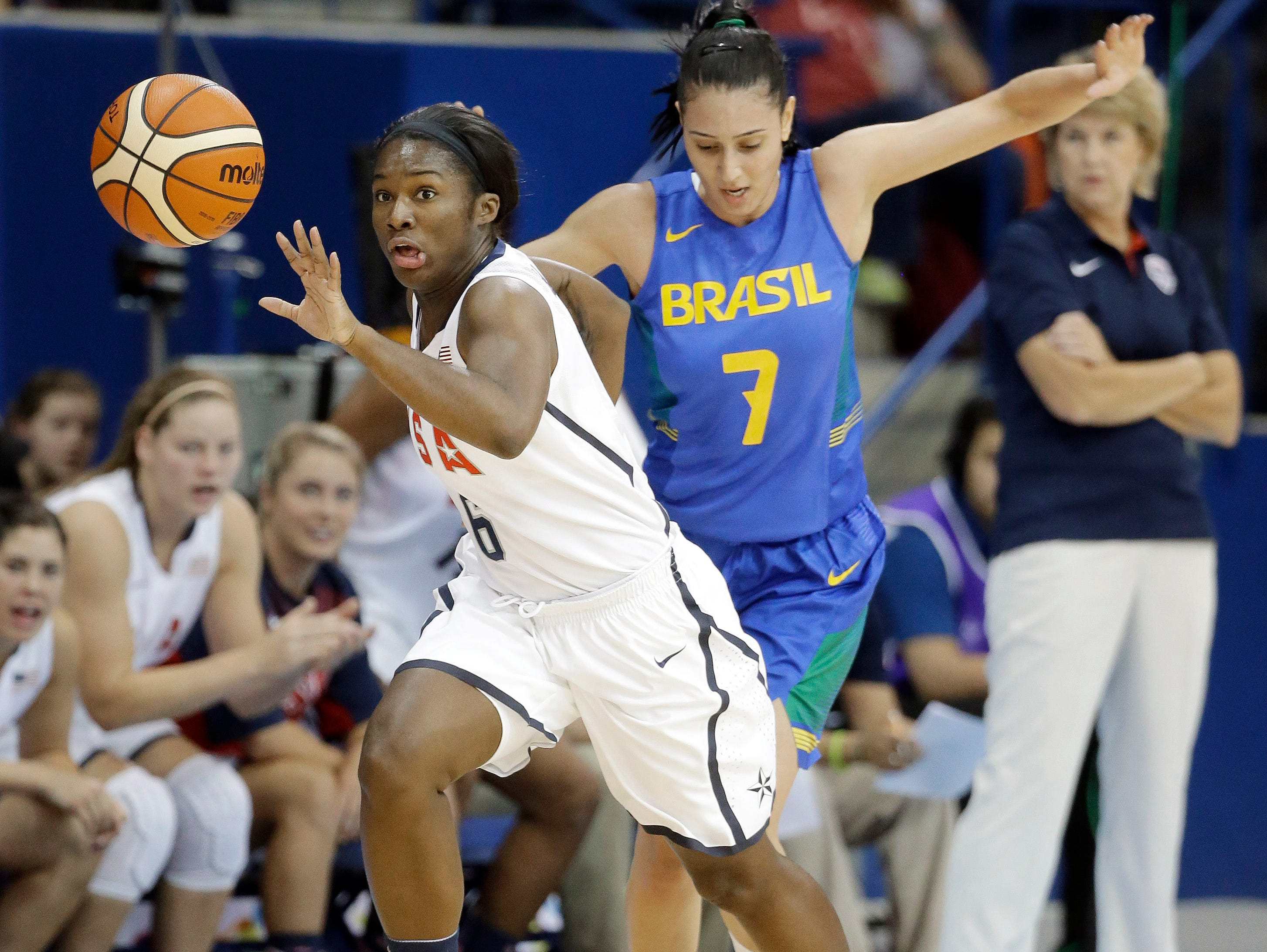 Linnae Harper (6) of the United States breaks down the court ahead of Patricia Teixeira (7) of Brazil in the first half of a women's preliminary round basketball game at the Pan Am Games Thursday, July 16, 2015, in Toronto. (AP Photo/Mark Humphrey)