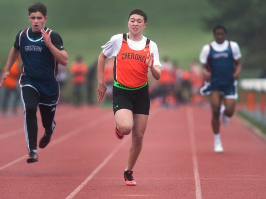 Matt Dawkins, center, a 17-year-old transgender male who is a junior member of the Cherokee High School boys' track team, wins his heat as he runs the 100-meter dash while competing in his first spring track meet of the season as Cherokee hosted Eastern on Wednesday. 04.08.15