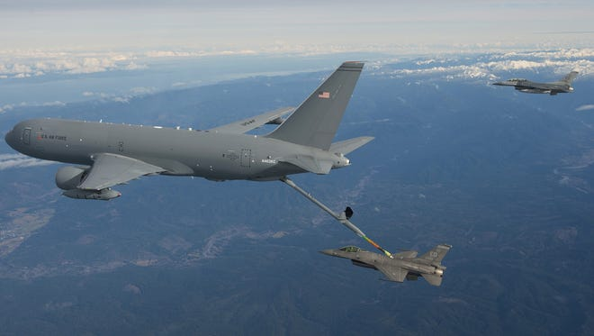 The KC-46A Pegasus performs its first-ever aerial refueling Jan. 24, 2016, passing 1,600 pounds of fuel to an F-16 Fighting Falcon.