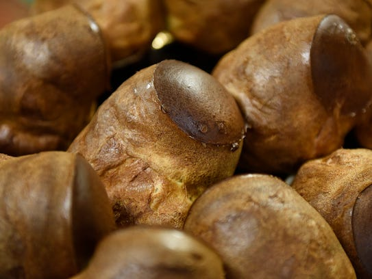 A tray of fresh popovers rests Wednesday, Dec. 16,