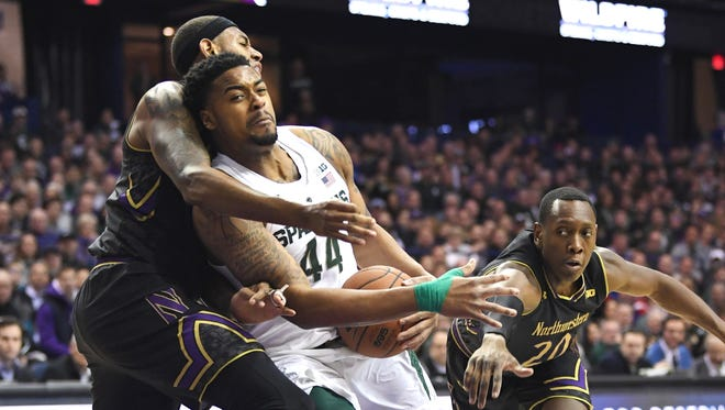 Michigan State Spartans forward Nick Ward (44) drives against Northwestern Wildcats center Dererk Pardon (left) and guard Scottie Lindsey (20) during the first half at Allstate Arena.