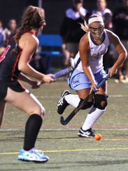 Capes Sydney Ostroski moves the ball to score Capes