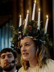 Anna Berg wears a crown of lighted candles as she portrays Sankta Lucia in a past Sankta Lucia Festival at California Lutheran University. This year's service will be at 11:25 a.m. Dec. 7 in Samuelson Chapel.