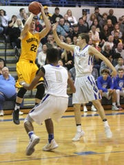 Northmor's Brock Pletcher launches a jump shot in a January game against St. Peter's.