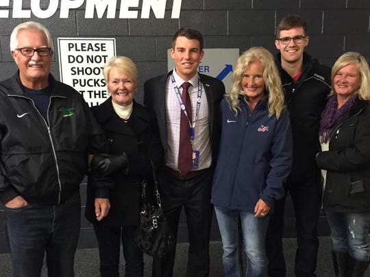 A hockey family (from left): Former MSU hockey coach and athletic director Ron Mason, his wife Marion, Tyler Walsh, Tracey Mason, Travis Walsh and Cindy Mason. Mason's daughter Tracey is Travis and Tyler's mother, and Cindy is their aunt.