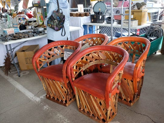 Vintage rattan and leather dining chairs at the Nashville