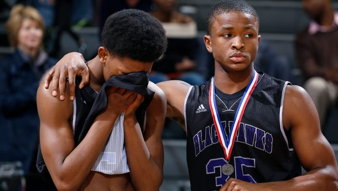 Bloomfield Hills' Xzavier Reynolds, left, is consoled by Remington Alexander following a 91-67 loss to Muskegon in the MHSAA Class A championship game on March 22, 2014, in East Lansing.