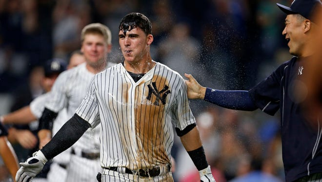 New York Yankees' Tyler Austin celebrates with Masahiro Tanaka, right, after hitting a walk-off home run off Tampa Bay Rays relief pitcher Erasmo Ramirez during the ninth inning of a baseball game Thursday, Sept. 8, 2016, in New York. The Yankees won 5-4.