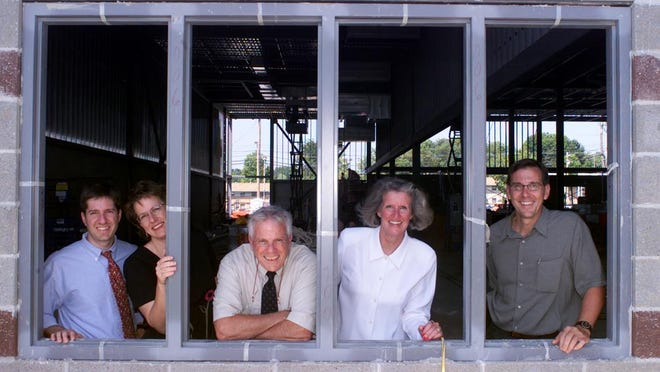 From left, Andy Waters, Mary Waters, Hank Waters, Vicki Russell and Jack Waters enjoy looking over construction in 2001 as the Tribune expanded its printing plant.