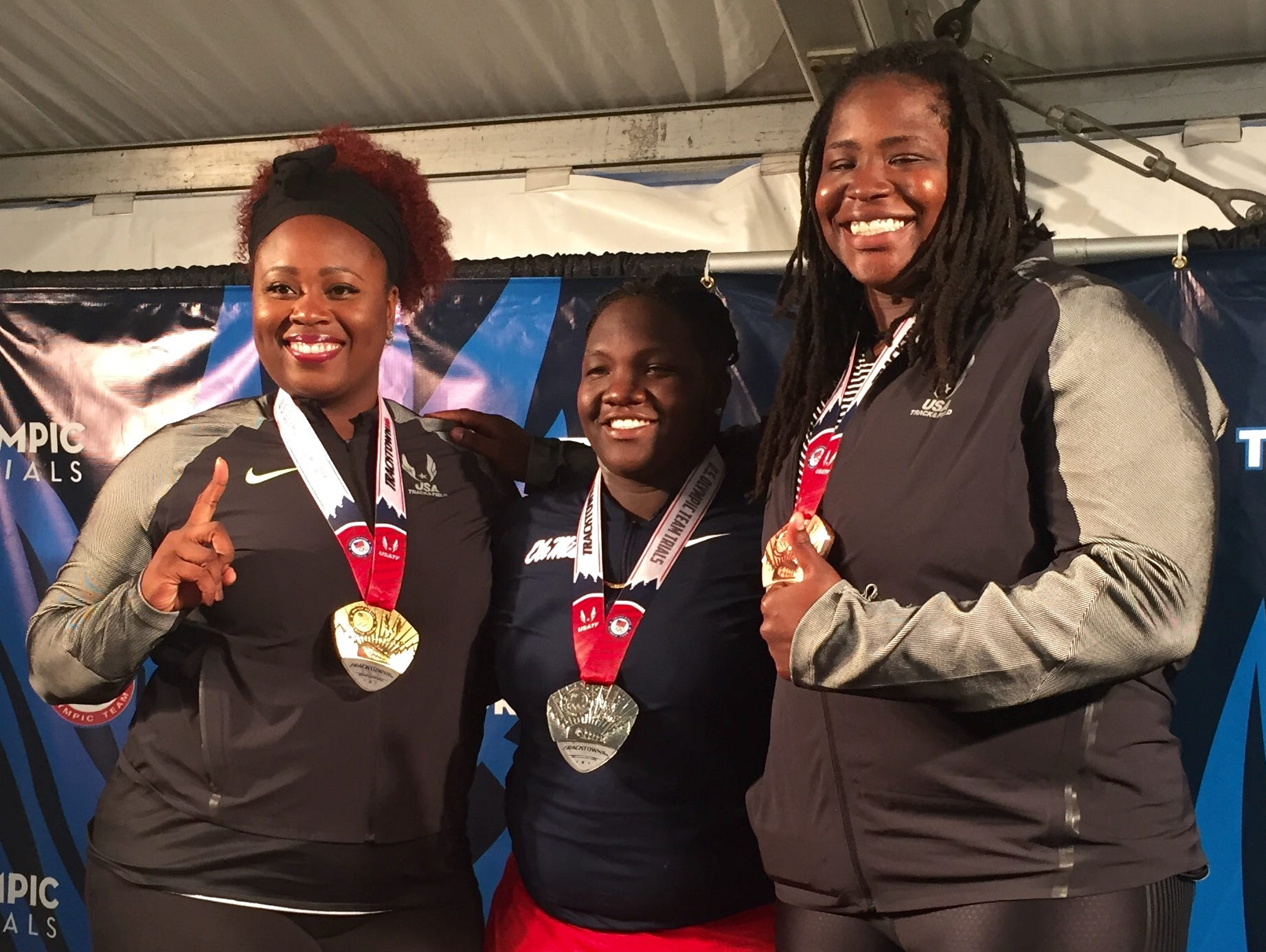 Felisha Johnson made the Olympic team with winner Michelle Carter, left, and Raven Saunders.