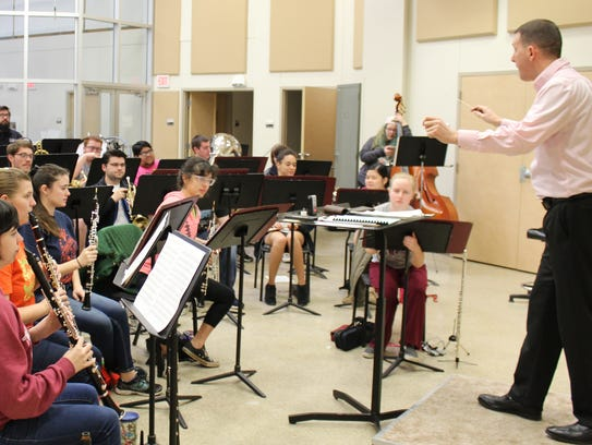 """David Robinson, director of bands at McMurry University, leads the wind ensemble in """"Short Ride in a Fast Machine"""" during a rehearsal Sunday afternoon. The group joined the university's choral group, the Chanters, on a spring break trip to New York City to perform at Carnegie Hall."""